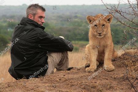 David Youldon with lion cub Jelani
