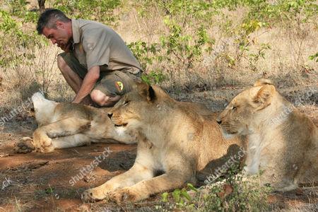 David Youldon with lion cubs Jelani and Jabari