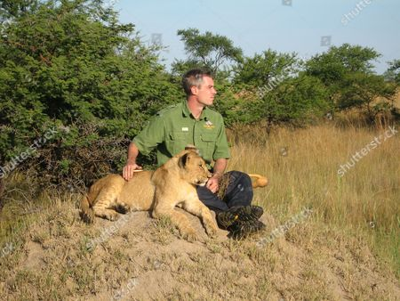 David Youldon with lion cubs