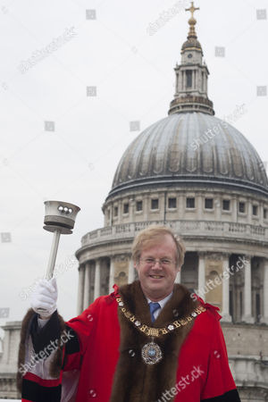 Lord Mayor David Wootton, holding the 1948 Olympic torch