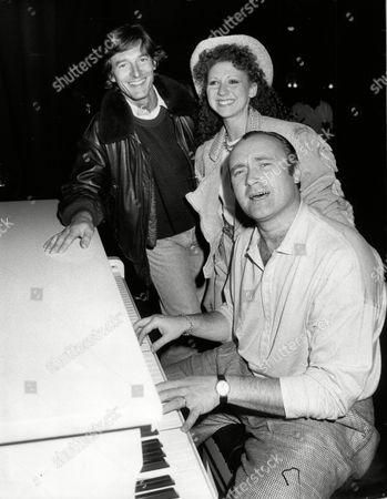 Phil Collins Pop Star At Piano With Singer-actress Bonny Langford And Actor Nigel Havers All At Theatre Royal Drury Lane For Terry Thomas Benefit Concert 1989.