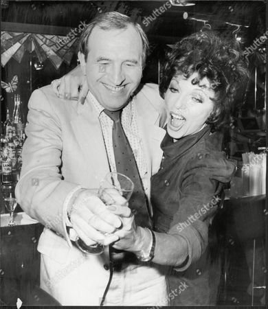 Actor Leonard Rossiter With Actress Joan Collins Leonard Rossiter (21 October 1926 A 5 October 1984) Was An English Actor Best Known For His Roles As Rupert Rigsby In The British Comedy Television Series Rising Damp (1974a78) And Reginald Iolanthe Perrin In The Fall And Rise Of Reginald Perrin (1976a79). These Roles Followed A Long And Distinguished Career In The Theatre.