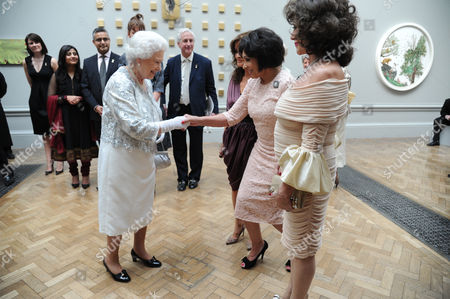 Queen Elizabeth II with Shirley Bassey and Joan Collins