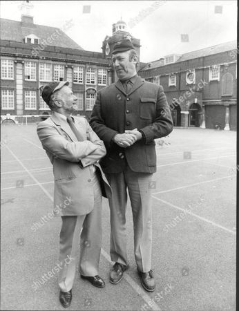 Actor Bernard Bresslaw With Journalist Jack Pleasant In Playground Of Their Old School Cooper's Company's School For Boys (now A Girls School) In The East End Of London Bernard Bresslaw (25 February 1934 A 11 June 1993) Was An English Actor. He Is Best Remembered For His Comedy Work Especially As A Member Of The Carry On Team.