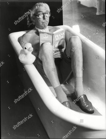 Television Presenter And Writer Frank Muir In The Bath Reading A Book With His Clothes On Frank Herbert Muir (5 February 1920 A 2 January 1998) Was An English Comedy Writer Radio And Television Personality And Raconteur. His Writing And Performing Partnership With Denis Norden Endured For Most Of Their Careers. Together They Wrote Bbc Radio's Take It From Here For Over 10 Years And Then Appeared On Bbc Radio Quizzes My Word! And My Music For Another 35. Muir Became Assistant Head Of Light Entertainment At The Bbc In The 1960s And Was Then London Weekend Television's Founding Head Of Entertainment. His Many Writing Credits Include Editorship Of The Oxford Book Of Humorous Prose.