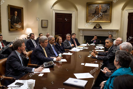 President Barack Obama drops by a meeting with Cabinet members in the Roosevelt Room of the White House -  Seated clockwise from the President: Commerce Secretary John Bryson; Homeland Security Secretary Janet Napolitano; Housing and Urban Development Secretary Shaun Donovan; Agriculture Secretary Tom Vilsack; Attorney General Eric H. Holder, Jr.; Administrator Karen Mills, Small Business Administration; Jeff Zients, Office of Management and Budget acting Director; Director of Communications Dan Pfeiffer; Senior Advisor David Plouffe; Mark Childress, Deputy Chief of Staff for Planning; Health and Human Services Secretary Kathleen Sebelius; and Secretary of the Interior Ken Salazar.