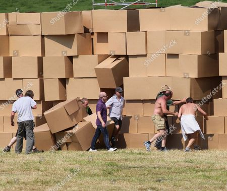 People race to find Gary Connery after he land on a pile of boxes