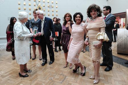 Joan Collins (R), Shirley Bassey (C), Kate O'Mara (L) and Joan Collins joke as they wait to meet Queen Elizabeth II