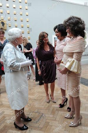 Joan Collins (R), Shirley Bassey (C) and Kate O'Mara (L) meet Queen Elizabeth II