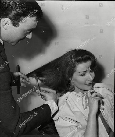 Actress Adrienne Corri Having Her Hair Cut By Hairdresser Adrienne Corri (born 13 November 1930) Is A Scottish-born Actress Of Italian Parentage. Despite Having Significant Roles In Many Films Adrienne Corri Is Likely To Be Remembered For One Of Her Smaller Parts That Of Mrs. Alexander The Wife Of The Writer Frank Alexander In The 1971 Stanley Kubrick Dystopian Film A Clockwork Orange. Though Not The Originally Cast For This Role She Was Brought In After The First Actress Left. Clad In An Eye Catching Bright Red Pajama Suit She Answers The Door To The Hero Of The Film Alex De Large And In A Scene Redolent With Black Humor And Violence Is Forcibly Stripped And Gang Raped Corri Being Thrust Center Stage In A Exuberant Quasi-theatrical Spectacle As Alex Accompanies The Stripping With A Joyful Rendition Of 'singing In The Rain'. Though The Scene Lasts Barely Three Minutes And Corri's Dialog Is Confined To Some Initial Preliminaries The Nature Of The Scene And The Manner Of Its Presentation Make It Perhaps The Most Memorable Scene In The Entire Film. Corri Appeared In Many Excellent Films Notably As Valerie In Jean Renoir's The River (1951) As Lara's Mother In David Lean's Dr. Zhivago (1965) And In The Otto Preminger Thriller Bunny Lake Is Missing . She Also Appeared In A Number Of Horror And Suspense Films From The 1950s Until The 1970s Including Devil Girl From Mars The Tell-tale Heart A Study In Terror And Vampire Circus. She Also Appeared As Therese Duval In Revenge Of The Pink Panther. The Range And Versatility Of Her Acting Is Shown By Appearances In Such Diverse Productions As The 1969 Science Fiction Movie Moon Zero Two Where She Played Opposite The Ever Dependable Character Actor Sam Kyd (len The Barman) And Again In 1969 In Twelfth Night Directed By John Sichel As The Countess Olivia Where She Played Opposite Alec Guinness (malvolio)