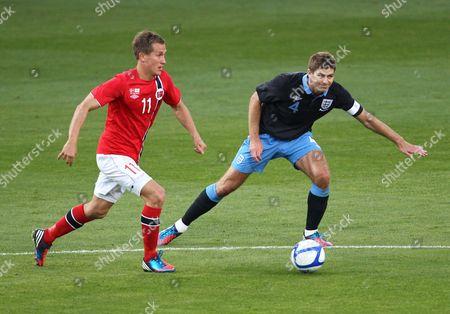 Steven Gerrard of England in action with Morten Gamst Pedersen of Norway