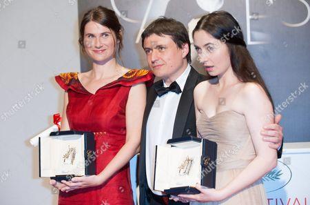 Best Actresses Cosmina Stratan and Cristina Flutur (R) for 'Beyond The Hills' with Cristian Mungiu (C)