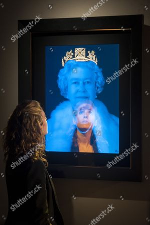 Stock Photo of Sophie Hugh Williams reflected in a work by artist Chris Levine depicting Queen Elizabeth II displayed at Asprey the jewellers.