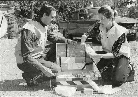 Dr Peter Griffin And Dr Rita Radford Members Of The Medical Emergency Sevice Checking Blood Transfussion Equipment