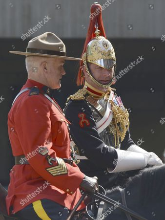 Editorial picture of Canadian mounties rehearse with members of the Household Cavalry to guard the Queen at Horse Guards Parade, London, Britain - 22 May 2012