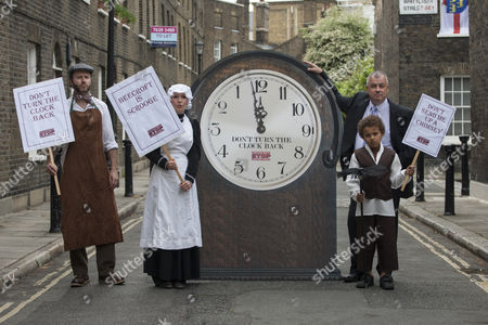TUC General Secretary Brendan Barber (right) posing with people dressed as Victorian workers and a six foot clock as TUC launches employment rights campaign