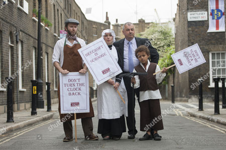 TUC General Secretary Brendan Barber (right) posing with pople dressed as Victorian workers as TUC launches employment rights campaign