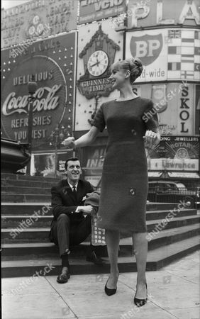 Ann Chivers Actress With Her Fiancae Alan Poston Drummer For Singer Pj Proby (not Shown) At Piccadilly Circus 1965.