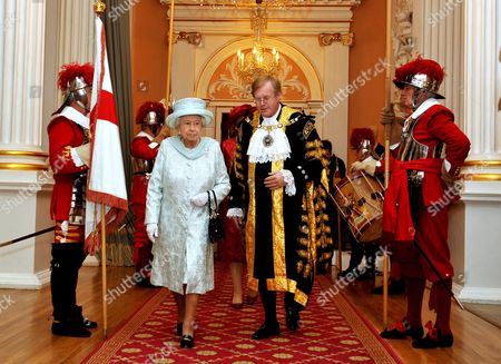 Queen Elizabeth II walks with David Wootton the Lord Mayor of London, after arriving at Mansion House in the City of London, for a reception in honour of her Diamond Jubilee.