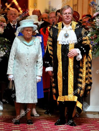 Queen Elizabeth II stands next to David Wootton the Lord Mayor of London, as they listen to a Choir before she leaves Mansion House in the City of London, after a reception hosted by the Lord Mayor in honour of her Diamond Jubilee.