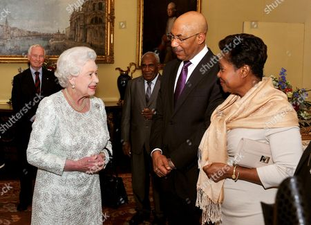 Stock Picture of Queen Elizabeth II talks with Sir Patrick Allen (2nd right) the Governor-General of Jamaica and his wife Patricia (right)