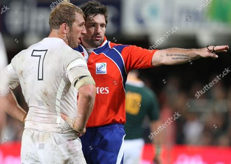 Referee Steve Walsh chats to Chris Robshaw