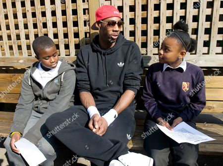 Phillips Idowu is interviewed by youngsters at his former school, De Beauvoir Primary School in Hackney.  Idowu visited the school to talk with the pupils.