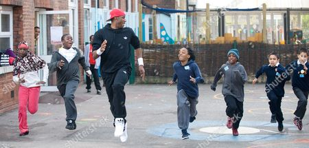 Phillips Idowu at his former school, De Beauvoir Primary School in Hackney.  Idowu visited the school to talk with the pupils.