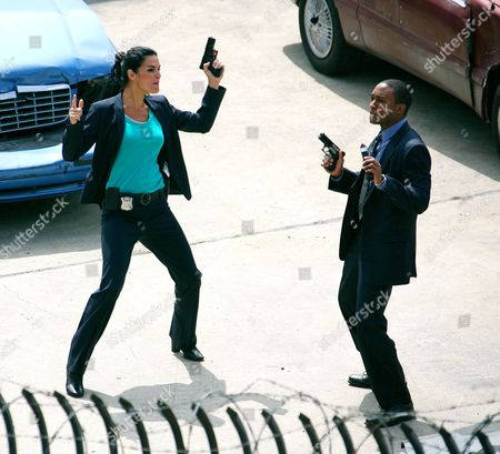 Stock Image of Angie Harmon and Lee Thompson Young
