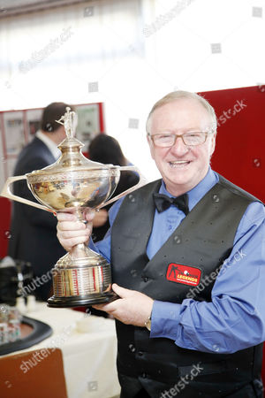 Player Dennis Taylor with World snooker trophy