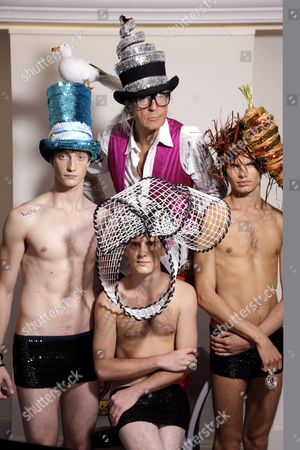 David Shilling with models wearing his hat designs