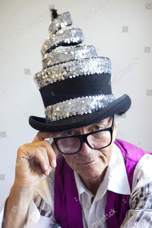 David Shilling wearing one of his hat designs