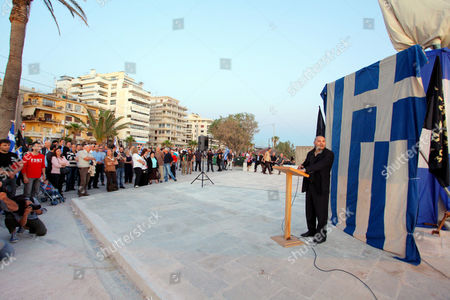 Stock Photo of Chrysi Avgi of the Golden Dawn Party supporters with Greek flags at a right rally at Palaio Faliro