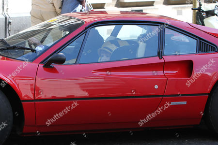 Chris Evans drives off with son Noah Evans in his Ferrari