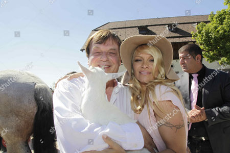 Michael Aufhauser and Pamela Anderson
