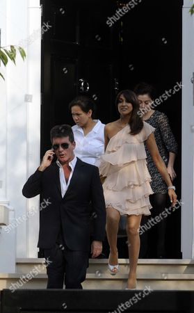 Simon Cowell With Companion Jackie St Claire Leave His Home In Kensington Tonight.