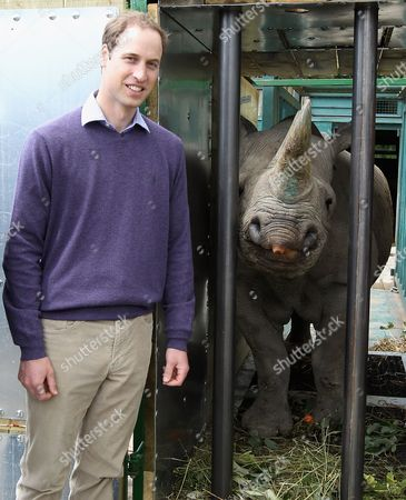 Prince William poses with a 5 year old black John Edwards called Zawadi