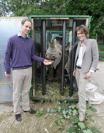Prince William poses with 5 year old black John Edwards called Zawadi and BBC's Kate Silverton