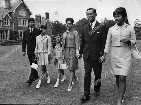 The Thailand Royal Family Walk Through The Gardens Of Their Residence At Sunninghill Berkshire Where They Are Staying During Their Private Visit To Britain. L To R King Bhunigol Of Thailand Princess Sirindhorn Aged 11 Queen Sirikit Princess Chulabhorn Aged 9 Crown Prince Vajiralongkorn Aged 13 And Princess Ubol Ratana Aged 15