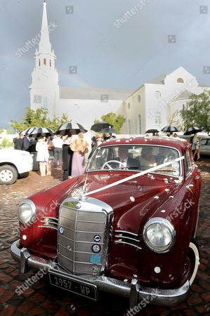 Stock Image of South African model Minki van der Westhuizen and former Lions rugby captain Ernst Joubert leaving the Andy Murray church