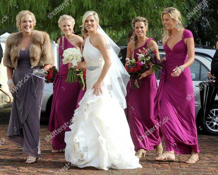 Stock Photo of South African model Minki van der Westhuizen and her bridesmaids arrive