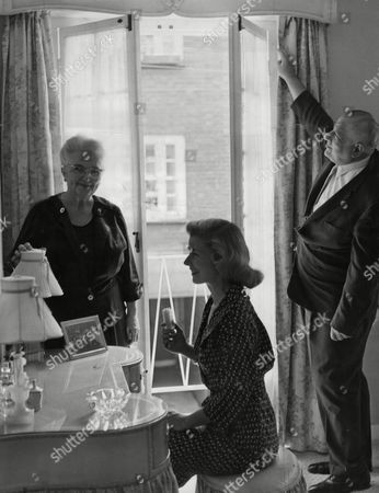 Mrs Louise Collins And Her Parents Dr And Mrs Andrew Cordier In The Bedroom Of Her Mews Home On The Dressing Table Stands A Picture Of Louises Husband Peter