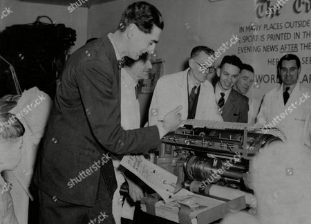 Dennis Norden Operating The 'stop Press' Machine On The Evening News Stand At The Daily Mail Ideal Home Exhibition.