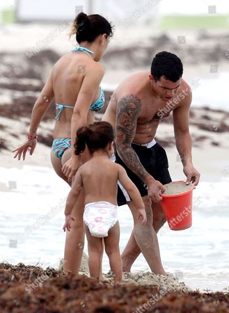 Editorial picture of Carlos Tevez enjoying a day at the beach with his family in Miami, America - 25 Jun 2012