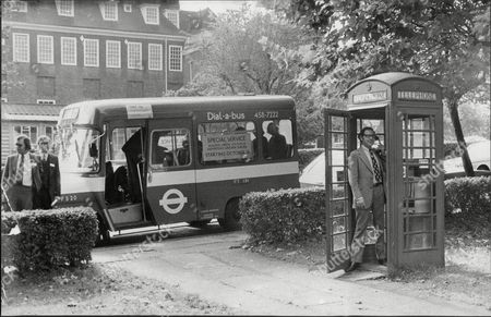 Editorial picture of London Red Bus Andrew Mcintosh Chairman Of The Western Area Board Of Greater London Council Telephones For A Bus In Hampstead Garden Suburb During Press Demonstration Of 'dial-a-bus'