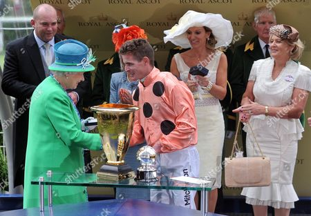 Queen Elizabeth II congratulates Luke Nolen who won The Diamond Jubilee Stakes on Black Caviar