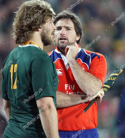 Referee Steve Walsh chats to Frans Steyn