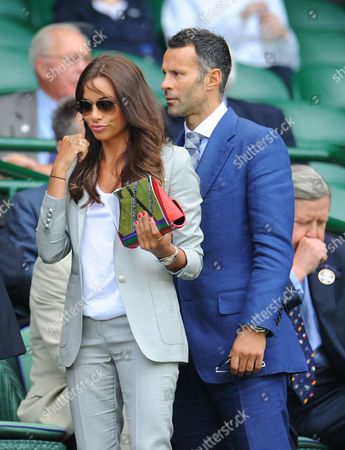 Footballer Ryan Giggs arrives in the Royal Box on Centre Court with his wife Stacey Giggs