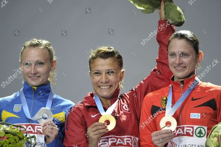 Turkey's Gulcan Mingir received her gold medal for women's 3000 m steeplechase, Ukraine's Svitlana Shmidt (L) was second, Antje Moeldner-Schmidt (R) took bronze