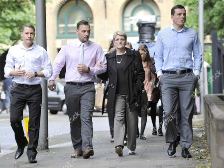 Ian Tomlinson's family, led by his widow Julia and her son Paul King (centre left)